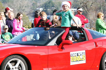 Georgia Anne  and Jack Butler tossing candy at the 2011 Christmas parade