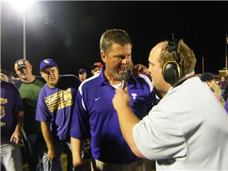 Miles Hathcock with Coach Rodney Dollar after Tallassee's 17-14 overtime win over Valley for the Region Title in 2009