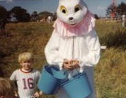 Young Michael standing beside Peter Cottontail for the WTLS & Tallassee Rescue Squad's Annual Easter Egg Hunt